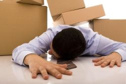 Person under a pile of boxes